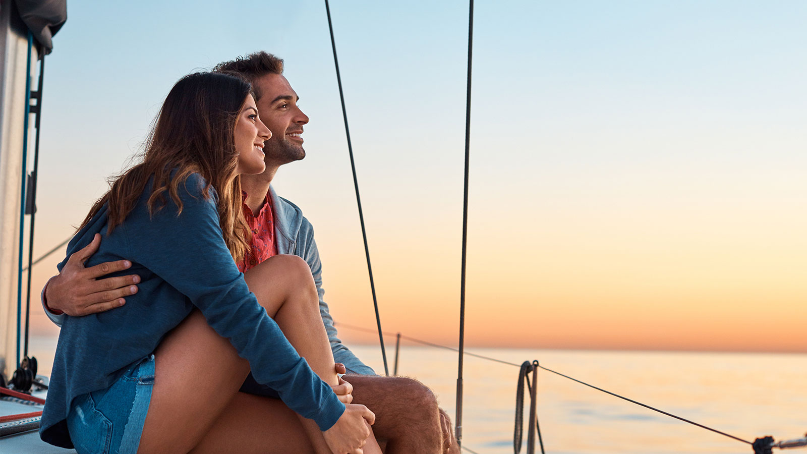Woman and man embraced watching sunset